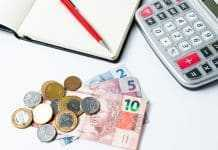 Concept of controlling spending at home or business - calculator - money - bills