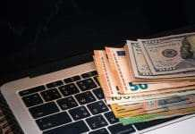 Dollar banknote over keyboard with forex statistic graph, Forex online trading concept